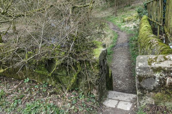 Left through narrow gap in wall