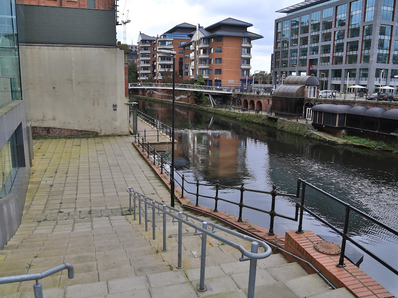 steps down to River Irwell
