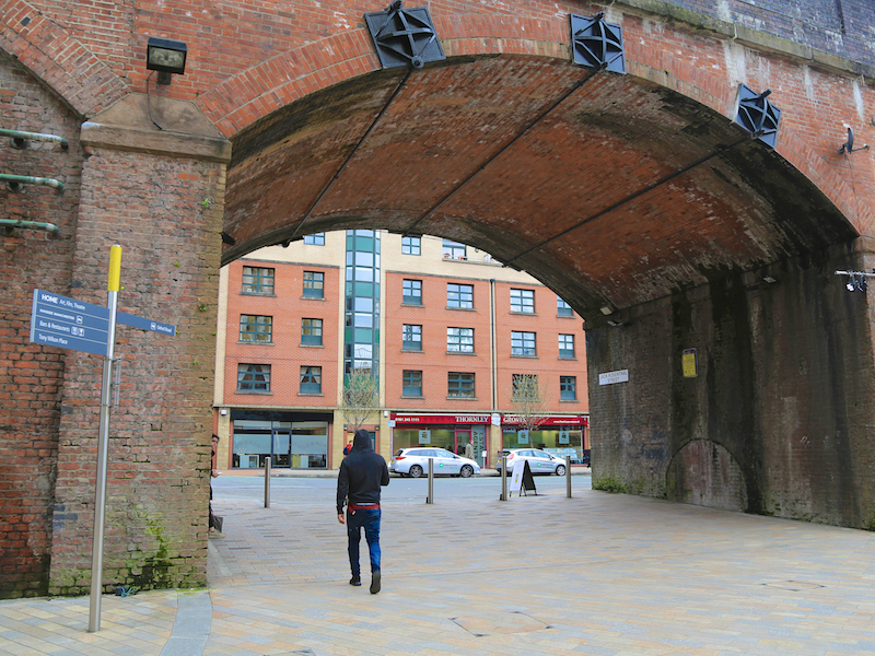 To Whitworth Street West through railway arch