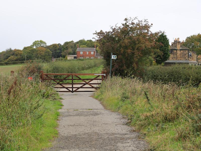 Road passes through gate