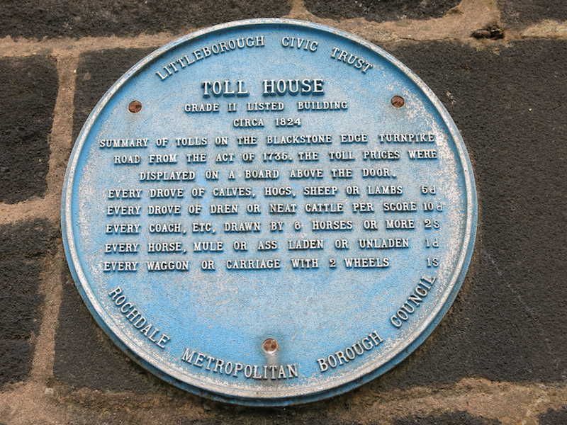 Plaque showing tolls