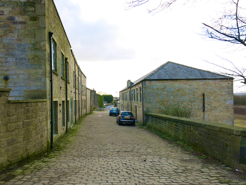 Left between mill buildings